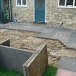 Removing the old patio slabs